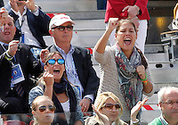 Italian tennis player Flavia Pennetta (L)and  applauds her boyfriend Italy's Fabio Fognini during his Davis Cup quarter-final tennis match against Britain's Andy Murray in Naples April 6, 2014.