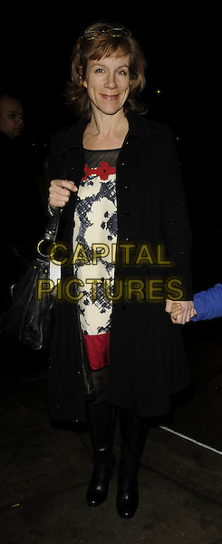 JULIET STEVENSON.The MAP Gaza benefit dinner, Grosvenor House hotel, Park Lane, London, England..January 25th, 2009.full length black coat jacket boots jeans denim bag purse dress white pattern red.CAP/CAN.©Can Nguyen/Capital Pictures.