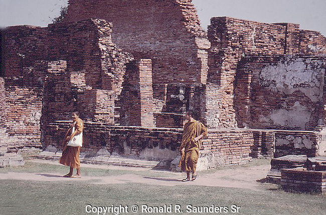 TWO MONKS AT RUINS IN THAILANDS OLD CAPITAL AYUTTHAYA