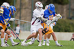 Los Angeles, CA 04/02/10 - Max Zeff (LMU #26), Kenny Smith (UCSB #4), Jonathan Kintzele (UCSB #22) and others in action during the UCSB-LMU MCLA SLC conference lacrosse game at Loyola Marymount University.