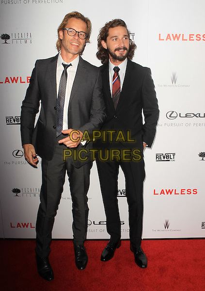 "Guy Pearce, Shia LaBeouf.""Lawless"" premiere held at ArcLight Cinemas, Hollywood, California, USA..August 22nd, 2012.full length hands in pockets black suit white shirt tie beard facial hair red grey gray glasses .CAP/ADM/KB.©Kevan Brooks/AdMedia/Capital Pictures."