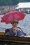 Henley Regatta. Spectator with pink parasol. Oxfordshire England.  The English Season published by Pavilon Books 1987. Page 139. <br /> <br /> Mrs Carrie M Davis, she was a regular and always carried this pink parasol during Henley week.