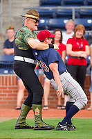 "Former WWF star Sergeant Slaughter uses the ""Cobra Clutch"" on a ""player"" that was bad-mouthing the United States of America prior to the start of the International League game between the Lehigh Valley IronPigs and the Durham Bulls at Durham Bulls Athletic Park June 26, 2010, in Durham, North Carolina.  Photo by Brian Westerholt / Four Seam Images"
