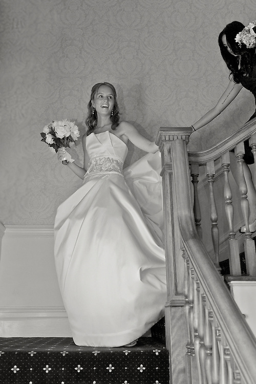 The bride coming down the staircase at Apawamis Country Club, Rye, NY