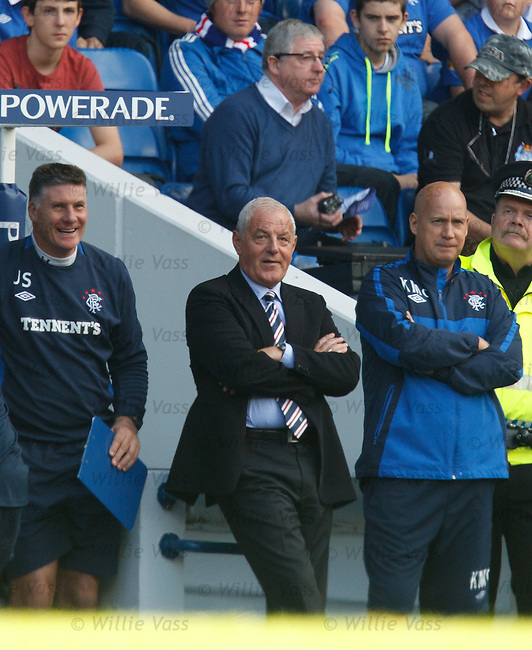 Walter Smith relaxing on the dugout wall as he watches Rangers cruise to a win over Newcastle Utd