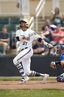 CJ Hammonds (21) of the Queens Royals follows through on his swing against the Mars Hill Lions at Intimidators Stadium on March 30, 2019 in Kannapolis, North Carolina. The Royals defeated the Bulldogs 11-6 in game one of a double-header. (Brian Westerholt/Four Seam Images)