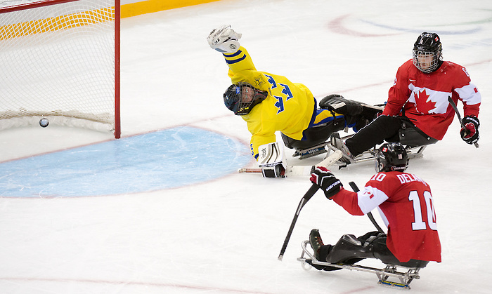 Sochi, RUSSIA - Mar 8 2014 -  Ben Delaney and Tyler McGregor look on as a goal gets past the Swedish goalie as Canada takes on Sweden during the 2014 Paralympic Winter Games in Sochi, Russia.  (Photo: Matthew Murnaghan/Canadian Paralympic Committee)
