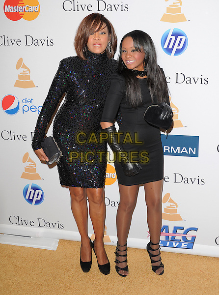 WHITNEY HOUSTON & BOBBI KRISTINA BROWN .attends the Annual Clive Davis & The Recording Company Pre-Grammy Gala - Salute To Icons held At The Beverly Hilton Hotel, Beverly Hills, California, USA, 12th February 2011..Full  length black sequined sequin dress long sleeve clutch bag polo high neck   shoes daughter family mum mom mother  gloves                                              .CAP/RKE/DVS.©DVS/RockinExposures/Capital Pictures.