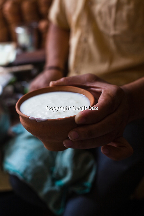 A small glass of lassi (yogurt drink) is posed for a photo in the ancient city of Varanasi in Uttar Pradesh, India. Photograph: Sanjit Das/Panos