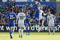 Matt Grimes of Swansea City battles for a header during the Sky Bet Championship match between Swansea City and Cardiff City at the Liberty Stadium, Swansea, Wales, UK. Sunday 27 October 2019