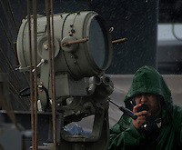 110509-N-DR144-578 INDIAN OCEAN (May 9, 2011) Operations Specialist 3rd Class David Ayala talks with other watch standers on a sound-powered telephone while standing watch as a lookout during a rain storm on the signal bridge of the Nimitz-class aircraft carrier USS Carl Vinson (CVN 70). Carl Vinson and Carrier Air Wing (CVW) 17 are underway in the U.S. 7th Fleet area of responsibility. (U.S. Navy photo by Mass Communication Specialist 2nd Class James R. Evans / Released)