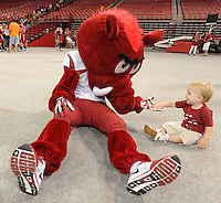 NWA Media/ANDY SHUPE - Big Red, the University of Arkansas Razorbacks mascot, gets a high-five from 13-month-old Oliver Marks of Fayetteville during the annual  University of Arkansas Fan Day Sunday, Aug. 17, 2014, at Bud Walton Arena in Fayetteville. The day featured opportunities to have items autographed by members of the Razorbacks volleyball, soccer, football teams, mascots and the spirit squads. Visit photos.nwaonline.com to see more photos from the event.