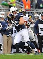 01 November 2014:  Penn State TE Jesse James (18) drags a Maryland defender down the sideline after a catch. The Maryland Terrapins defeated the Penn State Nittany Lions 20-19 at Beaver Stadium in State College, PA.