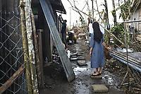 Sister Gertrude in the courtyard of her father place that she hasn't seen since one year. As she is often on assignment all around the Philippines it is very rare that she can visit her family. This day, she brought some food reliefs to her father who has the roof of his house completly destroyed by the typhoon. <br /> <br /> Soeur Gertrude dans la cour de la maison de son p&egrave;re qu'elle n'a pas vu depuis un an. Comme elle est souvent en mission partout dans le Philippines, il est tr&egrave;s rare qu'elle puisse rendre visite &agrave; sa famille. Ce jour-l&agrave;, elle apporte de la nourriture &agrave; son p&egrave;re qui a le toit de sa maison compl&egrave;tement d&eacute;truit par le typhon.