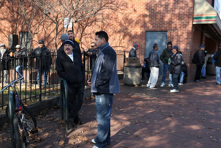 (171203RREI2587) La Esquina Documentary Project. Latinos have gathered near the 7 - 11 at the corner of Mt. Pleasant St. and Kenyon St. NW. for more than 40 years.  Mt. Pleasant, Washngton DC Dec. 3 ,2017 . ©  Rick Reinhard  2017     email   rick@rickreinhard.com