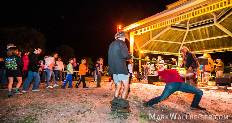 Drunken limbo on the beach as Swami and the Festoons play at the 2017 Wind Ceremony at Shell Point Beach in the Wakulla County panhandle of Florida put on by the Shell Point Sailboard Club.