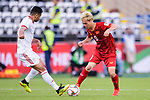 Nguyen Van Toan of Vietnam (R) fights for the ball with Omid Ebrahimi Zarandini of Iran (L) during the AFC Asian Cup UAE 2019 Group D match between Vietnam (VIE) and I.R. Iran (IRN) at Al Nahyan Stadium on 12 January 2019 in Abu Dhabi, United Arab Emirates. Photo by Marcio Rodrigo Machado / Power Sport Images