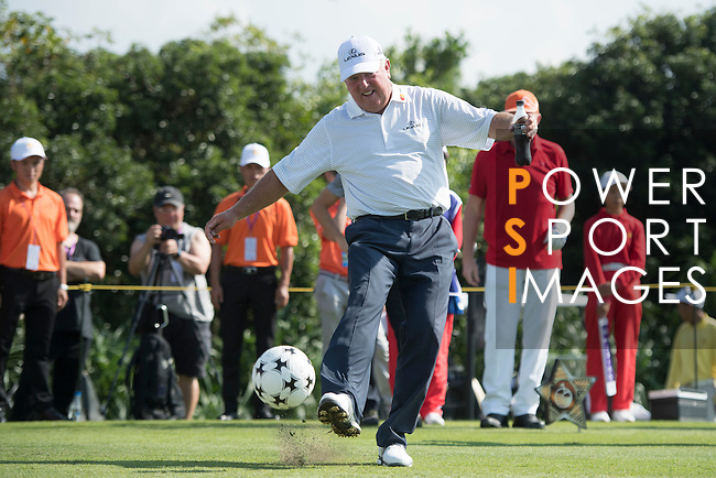 Mark O'Meara kicks a football at the 14th hole during the World Celebrity Pro-Am 2016 Mission Hills China Golf Tournament on 22 October 2016, in Haikou, China. Photo by Weixiang Lim / Power Sport Images