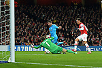 26.11.2013, Emirates Stadium London, UEFA Champions League, Arsenal FC  vs  Olympique Marseille, Gruppenphase, Pool E, im Bild <br /> <br /> Arsenal's Wojciech Szczesny makes a save from Marseille's Andre-Pierre Gignac, re Mesut Oezil (√Ėzil)<br /> <br /> Foto nph / Gunn