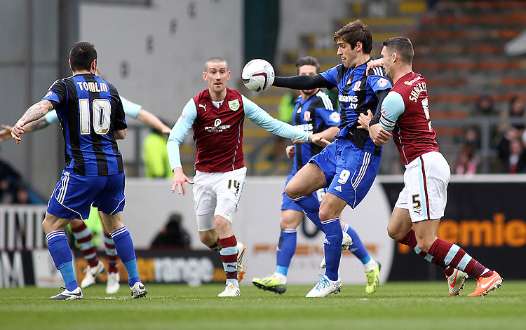Middlesbrough's Danny Graham shields the ball from Burnley's Jason Shackell <br /> <br /> Photo by Rich Linley/CameraSport<br /> <br /> Football - The Football League Sky Bet Championship - Burnley v Middlesbrough - Saturday 12th April 2014 - Turf Moor - Burnley<br /> <br /> &copy; CameraSport - 43 Linden Ave. Countesthorpe. Leicester. England. LE8 5PG - Tel: +44 (0) 116 277 4147 - admin@camerasport.com - www.camerasport.com