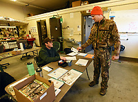 NWA Democrat-Gazette/FLIP PUTTHOFF<br /> PARK DEER SEASON<br /> David Eichorst (right) of Rogers checks in with Jacob Clary, a maintenance worker at Hobbs State Park-Conservation Area, after Eichorst hunted Saturday Jan. 6 2017 on the first day of the park's limited-permit muzzle-loader deer season. A total of 150 permits were issued for the hunt, which runs through Wednesday. Most of the park's trails and the public shooting range are closed for the hunt. Fifty seven hunters pursued deer in the park on Saturday morning. At 12,000 acres, Hobbs is the largest Arkansas state park and the only park that allows hunting. Hunters are required to check in at the park maintenance building before hunting and can do so as early as 4 a.m.