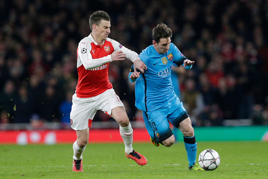 Barcelona's Lionel Messi holds off the challenge from Arsenal's Per Mertesacker<br /> <br /> Photographer Craig Mercer/CameraSport<br /> <br /> Football - UEFA Champions League Round of 16 - Arsenal v Barcelona - Tuesday 23rd February 2016 - Emirates Stadium - London<br /> <br /> &copy; CameraSport - 43 Linden Ave. Countesthorpe. Leicester. England. LE8 5PG - Tel: +44 (0) 116 277 4147 - admin@camerasport.com - www.camerasport.com