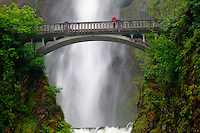 A visitor (MR) on the Benson Bridge and the Multnomah Falls off the Historic Columbia River Highway Columbia River Gorge National Scenic Area, Oregon