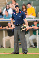 Home plate umpire Mathieu Moisan during the South Atlantic League game between the Augusta GreenJackets and the Kannapolis Intimidators at Fieldcrest Cannon Stadium July 24, 2009 in Kannapolis, North Carolina. (Photo by Brian Westerholt / Four Seam Images)