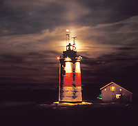 Söderarm Lighthouse lantern is lit by the full moon where the Stockholm Archipelago of Sweden meets the Sea of Åland.