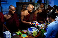 Followers of U Wirathu, the spiritual leader of the radical Buddhist 969 movement, buy 969 DVDs and stickers from monks before Wirathu delivers a sermon at Thein Taung Monastery in Taunggyi, Shan State. /Felix Features