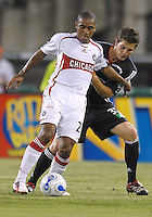 Chicago Fire forward Andy Herron (26) is defended by DC United's Bobby Boswell (32). DC United defeated the Chicago Fire 1-0, Wednesday, June 21, 2006.