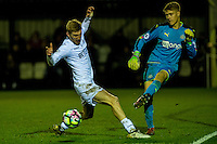Monday 16 January 2017<br /> Pictured: Oli McBurnie Swansea City challenges Nathan Harker of Newcastle United <br /> Re: During the Swansea City U23's match against Newcastle United U23's at the Landore Training facility, Swansea Wales UK