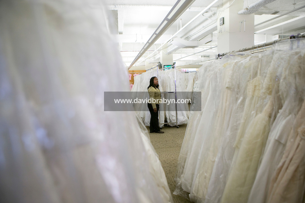 """A Filene's Basement employee waits for customers minutes before the 8am start of the annual """"Running of the Brides"""", a a first-come-first-served bridal gown sale, at the Filene's Basement store in New York City, USA, 3 March 2006."""