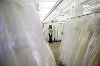 "A Filene's Basement employee waits for customers minutes before the 8am start of the annual ""Running of the Brides"", a a first-come-first-served bridal gown sale, at the Filene's Basement store in New York City, USA, 3 March 2006."
