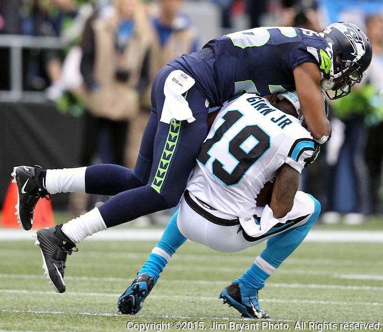 Seattle Seahawks  cornerback Cary Williams (26) wraps up Carolina Panthers wide receiver Ted Ginn (19)  at CenturyLink Field in Seattle on October 18, 2015. The Panthers came from behind with 32 seconds remaining in the 4th Quarter to beat the Seahawks 27-23.  ©2015 Jim Bryant Photography. All Rights Reserved.