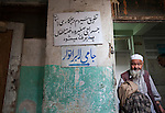 A local man leaves a doctors clinic in downtown Kabul.Street life in the Afghan capital of Kabul is full of interesting faces whose experience is often etched deep into the eyes. The exception being the women , whose eyes a casual observer rarely sees. Despite the ongoing struggle between radical Islamists and the moderate sections of Afghan society - and of course the coalition forces- the hospitality and vibrance of the locals is exhuberant. It has been centuries of struggle for these people and nothing, it seems , can break their spirit.