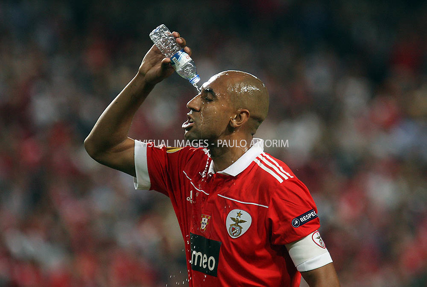 SL Benfica´s  defender Luizão from Brazil reacts with water   during the UEFA Europa League quarter final first leg  match betwenn SL Banfica 4 vs 1  PSV Eindhoven at Luz Stadium in Lisbon, on April 7, 2011.
