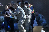 Fort Hood, TX - November 5, 2009 -- First responders carry a victim to an ambulance during the deadly shooting on Fort Hood, Texas, Thursday, November 5, 2009. Thirteen people were killed and 30 were injured in the incident. .Mandatory Credit: DoD Video Screengrab via CNP