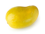Closeup of a ripe yellow Ataulfo mango tropical fruit isolated on white background