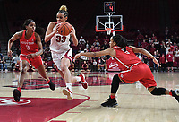 NWA Democrat-Gazette/J.T. WAMPLER Arkansas' Chelsea Dungee drives to the basket between Houston's Octavia Barnes (LEFT) and Angela Harris Thursday March 21, 2019 at Bud Walton Arena in Fayetteville during the first round of the Women's National Invitational Tournament. Arkansas won 88-80 in overtime. The Razorbacks take on University of Alabama at Birmingham at home on Sunday.