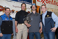 Nicolas Petit recieves the Alaska Airlnes Leonard Seppala Humanitarian Award from Pau G. Kosto, Stuart Nelson DVM --chief veterinarian, and Tim Thompson at the finishers banquet in Nome on Sunday  March 22, 2015 during Iditarod 2015.  <br /> <br /> (C) Jeff Schultz/SchultzPhoto.com - ALL RIGHTS RESERVED<br />  DUPLICATION  PROHIBITED  WITHOUT  PERMISSION
