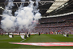 The two teams walking on to the pitch before the Npower Championship play-off final between Reading (blue) and Swansea City at Wembley Stadium. The match was won by Swansea by 4 goals to 2 watched by a crowd of 86,581. Swansea became the first Welsh team to reach the top division of English football since they themselves played there in 1983.