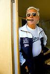 Jimmy Saville, British entertainer & disc jockey, TV & radio broadcaster, smoking a cigar. .