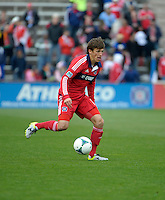 Chicago defender Wells Thompson (15) dribbles the ball.  The Chicago Fire defeated the New York Red Bulls 3-1 at Toyota Park in Bridgeview, IL on April 7, 2013.