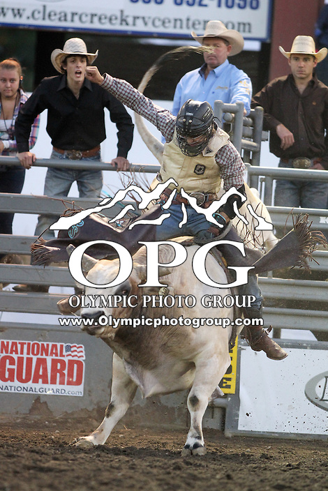 20 Aug 2014: Cain Smith riding the bull Game Face scored a 79.5 during the third round of the Seminole Hard Rock Extreme Bulls competition at the Kitsap County Stampede in Bremerton, Washington.