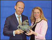 BNPS.co.uk (01202) 558833Pic: CanterburyAuction/BNPS<br /> <br /> Asian art expert, Alastair Gibson and auctioneer Cliona Kilroy with the rare Western Zhou water vessel which dates back to 1500 BC. The Zhou water vessel has sold for &pound;508,400.<br /> <br /> A Chinese relic looted from the Summer Palace by a British army officer 158 years ago has sold for more than half a million pounds after it was found in the attic of an unassuming English house.<br /> <br /> The 3,500 year old sacred Chinese bronze water vessel is one of seven known to exist, with five in museums, but Chinese officials said the stolen antiquity should be returned to China.<br /> <br /> The rare item was taken by Captain Harry Lewis Evans when the British and French arrived at the Emperor's Summer Palace in Peking - now Beijing - during the Second Opium War.<br /> <br /> Capt Evans wrote letters home describing the mystical palace and the looting of its treasures that took place in 1860.<br /> <br /> Along with the rare Tiger Ying, three other Chinese bronzes sold which brought the total to &pound;549,320 including premiums.<br /> <br /> China's State Administration of Cultural Heritage is believed to have said it was looking into the auction and opposed the sale and purchase of illegal cultural relics.