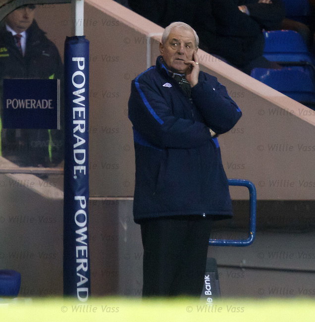 Walter Smith looking across at the time on the scoreboards