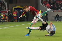 Zsolt Kalmar (L) of Hungary and Matias Vina (R) of Uruguay fight for the ball during the inauguration match of the newly reconstructed Ferenc Puskas Stadium between Hungary and Uruguay in Budapest, Hungary on Nov. 15, 2019. ATTILA VOLGYI