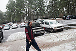 December 16, 2010. Raleigh, NC.. TP Mishra walks to talk to a neighbor in his apartment complex. There are immigrants from many countries in the complex, including Mexico, Somalia and Vietnam, most of whom are attracted by the cheap rent.. TP Mishra, a refugee from Bhutan, has recently relocated from the Bronx to Raleigh, where he lives in an suburban apartment  with his wife, as well as another Bhutanese couple.