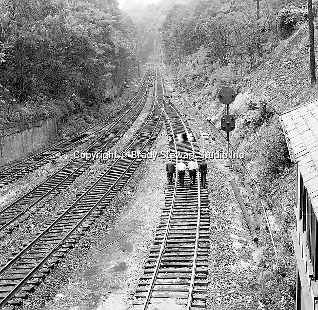 Corliss PA - View of inspectors walking the tracks near the PA Railroad station at Corliss Pennsylvania.  The assignment was for the PA Railroad due to a train derailment near the station - 1964.  Brady Stewart Studio was a contract photography studio for the railroad from 1955 through 1965.